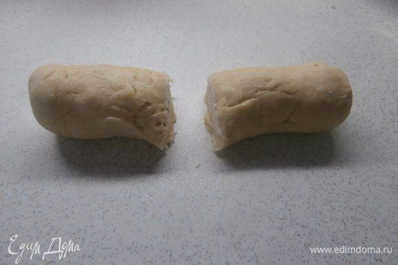 Вымесить тесто, добавляя по необходимости 3-ий ст. муки, разделить его на две части,одну часть отправить в морозильник на 30 мин.
