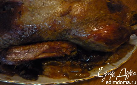 Рецепт Запеченная утка с яблоками и черносливом.