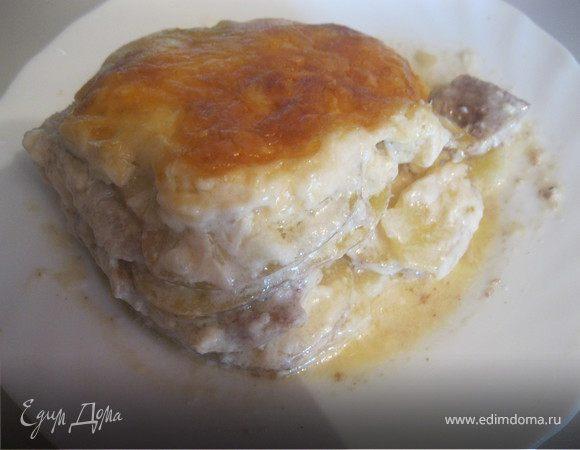 Свинина запеченная с картофелем под соусом