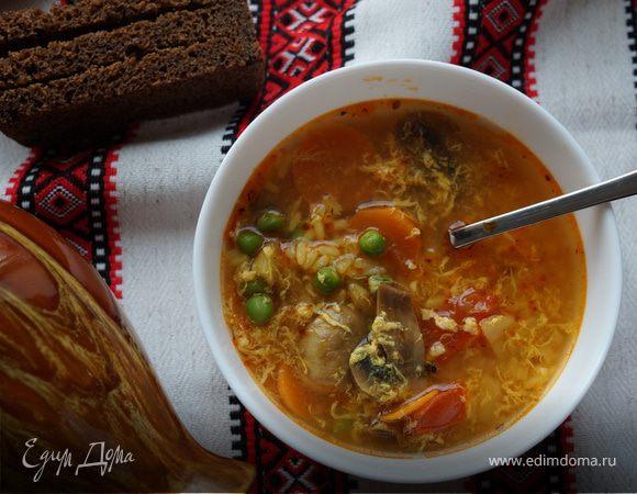 Острый суп с рисом и зеленым горошком