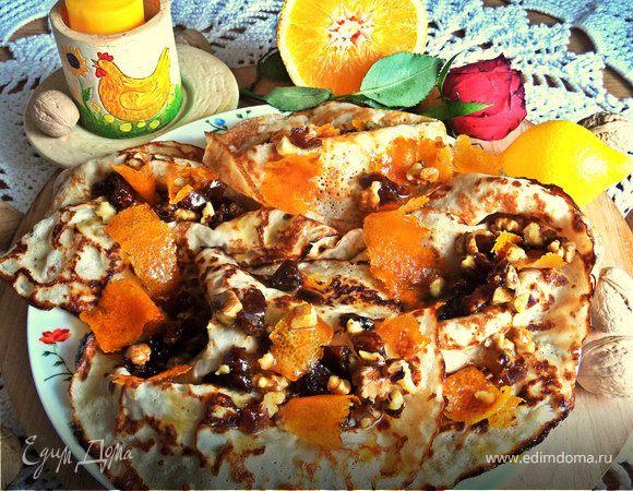 Блины с кокосом под апельсиновым соусом