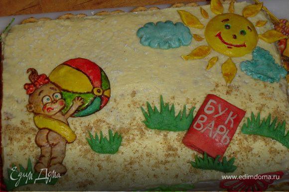 А теперь украшаем тортик. Для этого я использовала, выпеченные из пресного теста, фигурку девочки, солнышко и тучки.Траву и книгу, я сделала из мастики. Вот так выглядит торт в собранном виде.