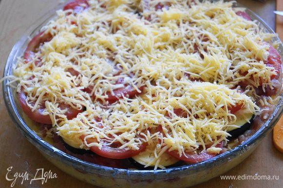 Залить взбитыми яйцами и присыпать обильно тертым сыром и поставить запекать в духовку разогретую до 180 градусов, на 45-50 минут.
