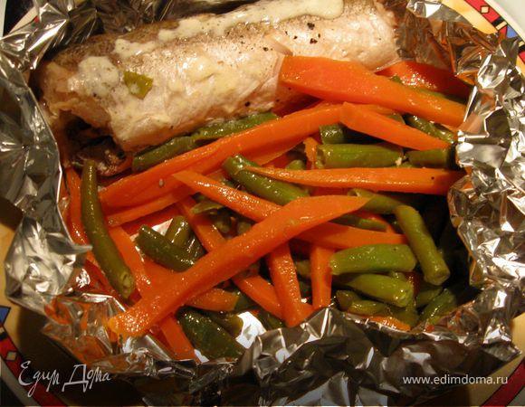 Хек на овощах под нежным сливочным соусом